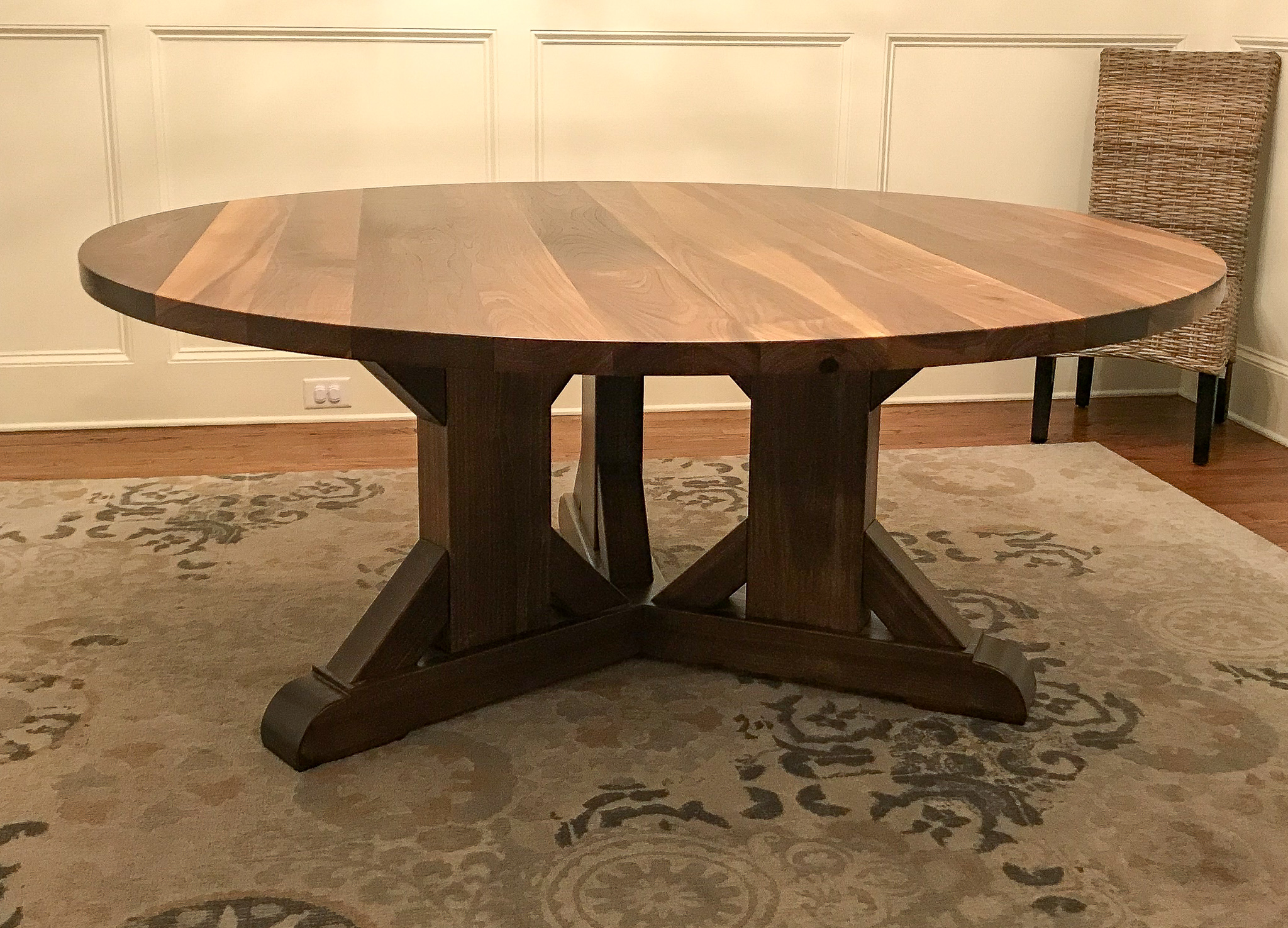 triple pedestal table in dining room with chair